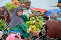 Mostly women transport all kinds of goods on small boats from nearby villages to the Lok Baitan Floating Market - Banjarmasin, Indonesia 2014