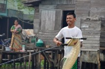 People live in wooden homes built over the water and fish or trade on the rivers - Banjarmasin, Indonesia 2014